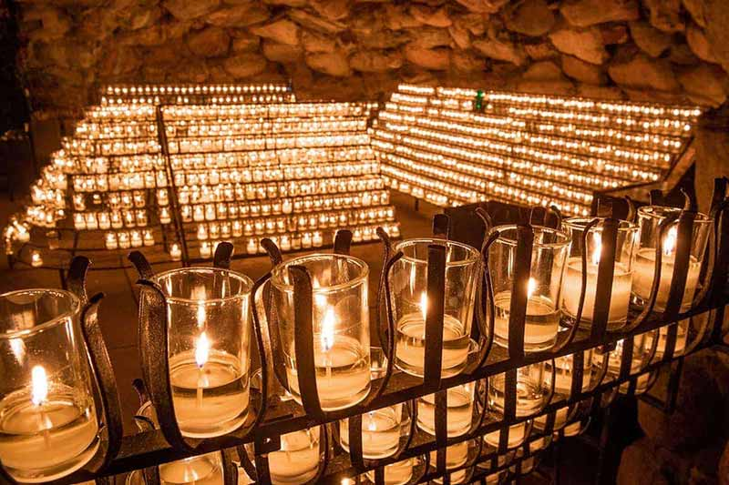 Candles shine brightly at the Grotto.