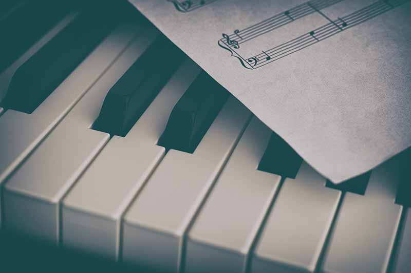 Piano keys and music papers.