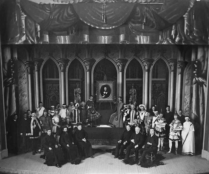 Shakespeare production cast photo taken in Washington Hall in 1885.