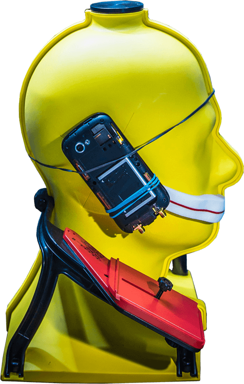 A yellow mannequin head with a modified mobile phone strapped to the side.
