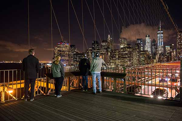 Junior engineering students take in the view of Manhattan from the Brooklyn Bridge