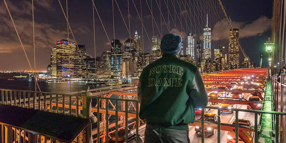 A junior civil engineering student, Adam Kuczynski, takes in the view of Manhattan from the Brooklyn Bridge.