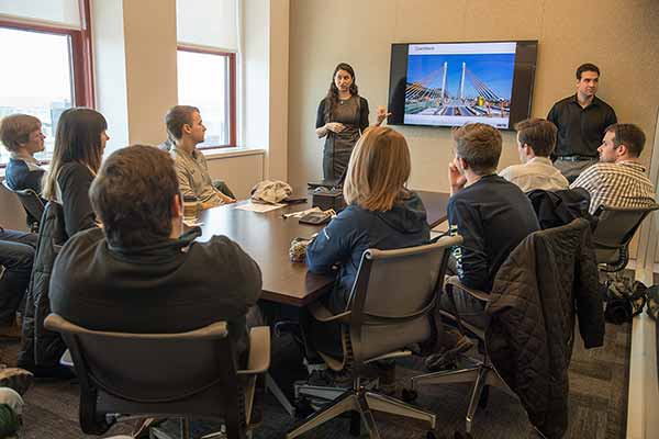 Students listen to HNTB presenter Allison Halpern and Patrick D'Ambrosio (right)  at the Empire State Building.
